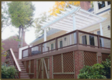 Custom Deck with TimberTech flooring,rails,and fascia.Vinyl Pergola and Privacy Screening in Bexley West Subdivision.