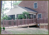 Wheelchair ramp and small deck with TimberTech decking and rails in Henrico West End.